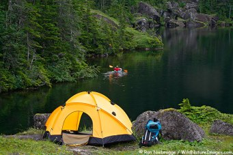 A backpacker enjoying a pack raft while camping on Culross Island, Prince William Sound, Chugach National Forest, Alaska. (MR)